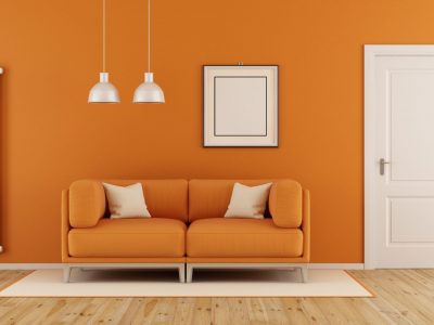 Orange,Living,Room,With,Modern,Couch,closed,Door,And,Vertical,Heater-3d